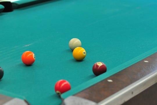 Billiards is a popular activity at senior centers.