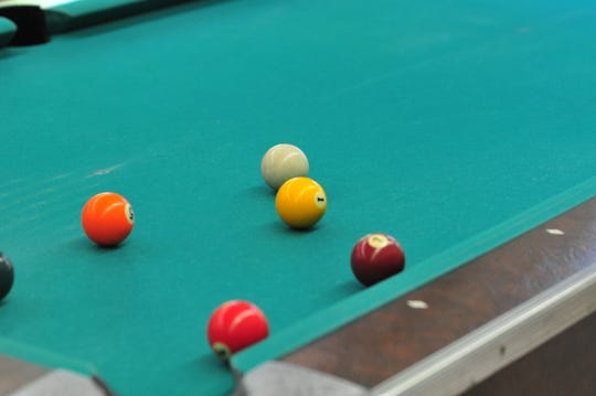 Billiards is a popular activity at senior centers.