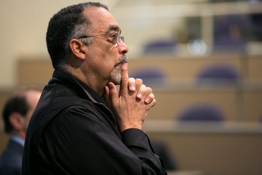 Paul Burgett, Vice President and Senior Advisor to the President, lsitens during a town hall discussion held as part of University of Rochester President Joel Seligman's Presidential Commission on Race and Diversity in Rochester on Monday, January 18, 2016. Mr. Burgett is co-chair of the commission.