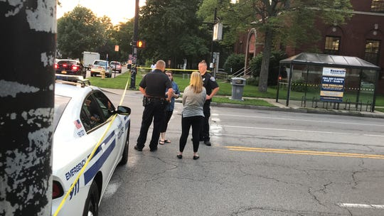 Rochester police investigators arrive at the scene of a fatal motorcycle crash on Lake Avenue in Charlotte Wednesday.