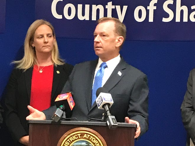 Stephanie Bridgett and McGregor Scott stand at a press conference in Redding on Aug. 23, 2018.
