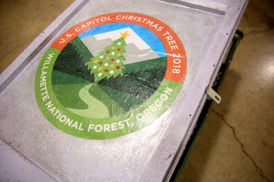 A wooden crate carrying a 14-foot tree skirt created for the 2018 U.S. Capitol Christmas Tree, which will come from the Willamette National Forest in Oregon. The tree skirt, created by the Gone to Pieces Quilt Guild out of Yamhill County, features panels with scenes from around Oregon and will be on display at the Oregon State Fair from Aug. 24 - Sept. 3. Photographed at the Oregon State Fairgrounds in Salem on Thursday, Aug. 23, 2018.