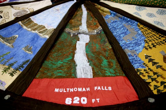 A panel with a Multnomah Falls scene on the 14-foot tree skirt created for the 2018 U.S. Capitol Christmas Tree, which will come from the Willamette National Forest in Oregon. The tree skirt, created by the Gone to Pieces Quilt Guild out of Yamhill County, features panels with scenes from around Oregon and will be on display at the Oregon State Fair from Aug. 24 - Sept. 3. Photographed at the Oregon State Fairgrounds in Salem on Thursday, Aug. 23, 2018.