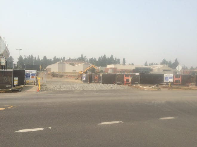 Construction continues at the Hayward Field site on a smoky Tuesday in Eugene.