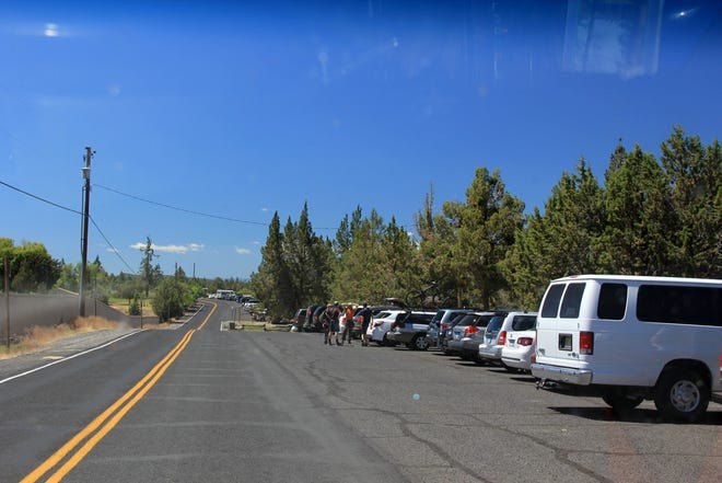 The parking lot at Smith Rock State Park is often overcrowded to the point that visitors must park up to a mile away.
