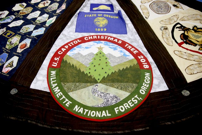 A 14-foot tree skirt created for the 2018 U.S. Capitol Christmas Tree, which will come from the Willamette National Forest in Oregon. The tree skirt, created by the Gone to Pieces Quilt Guild out of Yamhill County, features panels with scenes from around Oregon and will be on display at the Oregon State Fair from Aug. 24 - Sept. 3. Photographed at the Oregon State Fairgrounds in Salem on Thursday, Aug. 23, 2018.