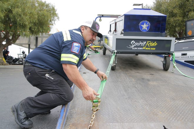 Ricardo Jaime, a truck driver for Pete's Towing, secures a coffin that represents first responders killed by errant drivers nationwide as part of the  Spirit Ride event Thursday in Salinas. He and other tow truck drivers then left in a procession to Soledad.
