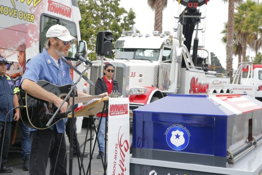 Mike Corbin, a member of the Spirit Team, sings at an event to remind drivers to be careful around first responders including tow truck drivers.