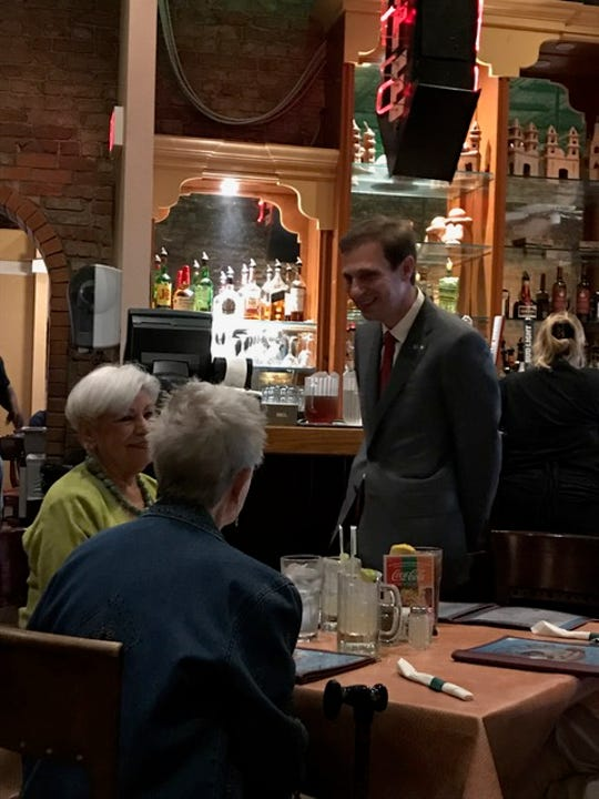 Justin Nelson speaks to supports at a campaign stop on Wednesday, Aug. 22.