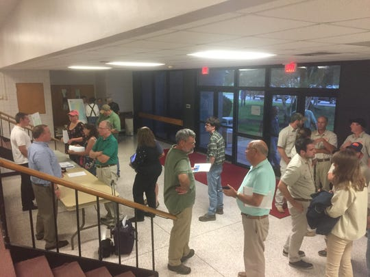 Attendees at an informational session on groundwater withdrawal permits ask questions of Department of Environmental Quality staff after a briefing at Arcadia High School in Oak Hall, Virginia on Wednesday, Aug. 22, 2018.