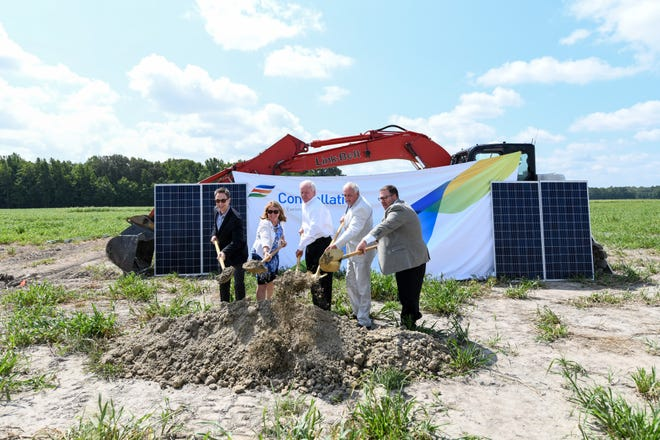 Elected officials and Constellation representatives shovel dirt during the ground breaking ceremony for the new solar farm that will help power Ocean City on Thursday, August 23.
