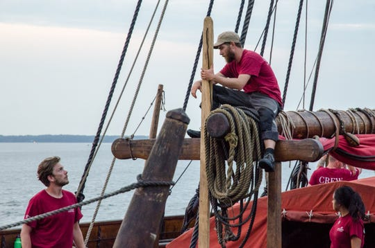 Mates aboard the Norwegian replica Viking ship Draken Harald Harfagre work quickly to tie up after docking at 3rd Street on Wednesday, August 22, 2018.