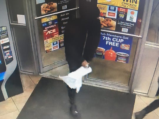 This still image captured from surveillance footage shows a suspect in an armed robbery at a Royal Farms in Princess Anne on Thursday, Aug. 23, 2018.