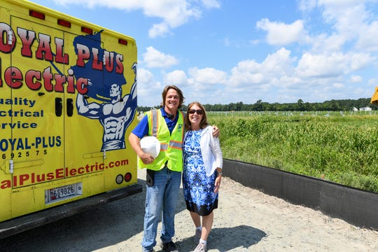 Mark Odachowski, President of Royal Plus Electric, and delegate Mary Beth Carozza pose after the ground breaking ceremony for the new solar farm that will help power Ocean City on Thursday, August 23. Local business Royal Plus Electric will be providing some of the labor for the solar project.