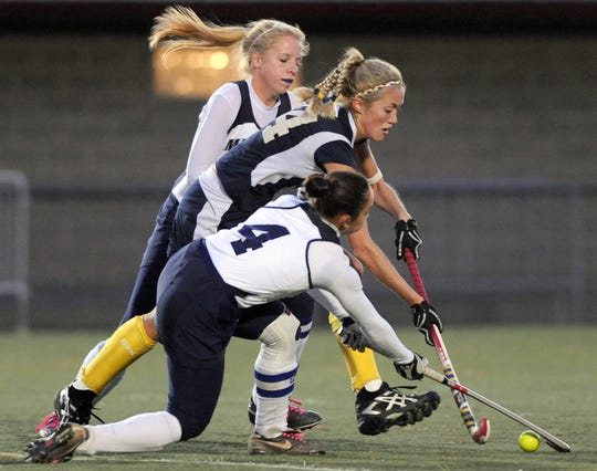 Pocomoke's Kasey Tapman tries to move the ball past Manchester Valley's Emily Diseroad, top, and Mandy Gates, bottom, during the first half of a Class 1A state semifinal Monday, Nov. 8, 2010 in Annapolis. Pocomoke won 2-1. (Photo by Steve Ruark for The Daily Times)
