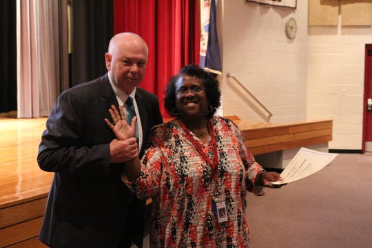 """Marlene Harmon is congratulated by Accomack School Superintendent W. C. """"Chris"""" Holland for 40 years of service to Accomack County Public Schools during a back-to-school celebration for school district employees at Nandua High School in Onley, Virginia on Wednesday, Aug. 22, 2018."""