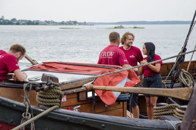 Mates aboard the Norwegian replica Viking ship Draken Harald Harfagre work quickly to tie up after docking at 3rd Street in Ocean City on Wednesday, August 22, 2018.