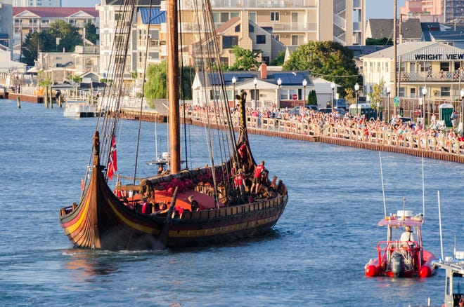 After passing through the Harry Kelley Memorial Bridge in downtown Ocean City, the Norwegian replica Viking ship Draken Harald Harfagre heads toward its docking place on 3rd Street. The ship will depart Ocean City on August 29 after an eight-day stay. August 22, 2018.