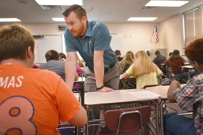 Roosevelt High School teacher Micah Nordin teaches his first class on the first day of school, Thursday, Aug 23, in Sioux Falls.