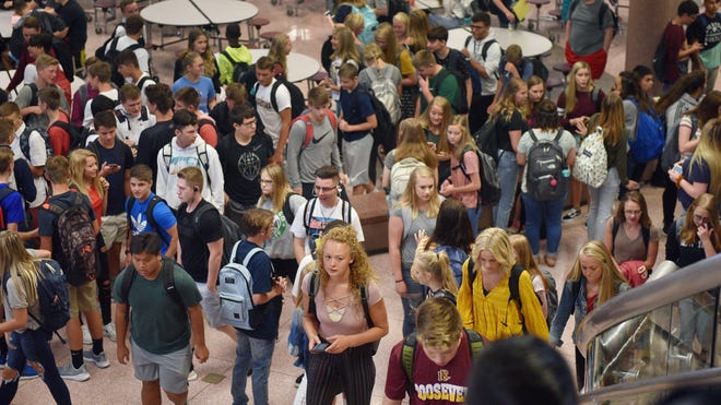 Roosevelt High School students walk to their first class on the first day of school, Thursday, Aug 23, in Sioux Falls.