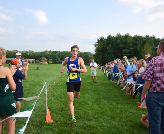 Fort Defiance's Jacob Jones cross the finish line to seal up the Indians victory in the boys relay at the Valley Cup cross country invitational on Wednesday, Aug. 22, 2018, at Wilson Workforce & Rehabilitation Center in Fishersville. Va.