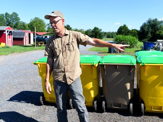 Eric Walter, president and chief composting officer of Black Bear Composting, talks about the collection bins used by their customers while discussing their operations during an interview in Crimora on Thursday, August 23, 2018.