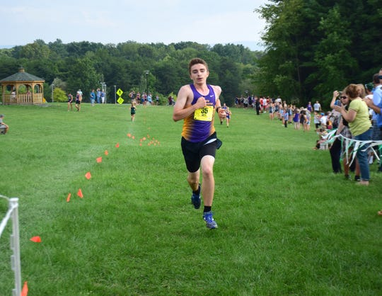 Waynesboro's Jacob Robeck reaches the finish line for the anchor leg of the boys relay at the Valley Cup cross country invitational on Wednesday, Aug. 22, 2018, at Wilson Workforce & Rehabilitation Center in Fishersville. Va.