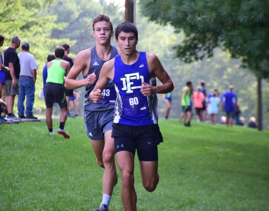 Fort Defiance's Ben Harlow stays ahead of Spotswood's Aidan Sheehan on the opening leg of the boys relay at the Valley Cup cross country invitational on Wednesday, Aug. 22, 2018, at Wilson Workforce & Rehabilitation Center in Fishersville. Va.