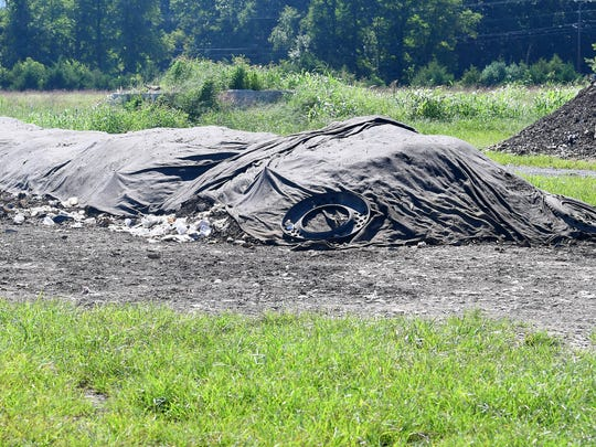 A covered pile comprised of food scraps, organic wastes and other such is still undergoing the process of composting  Black Bear Composting in Crimora on Thursday, August 23, 2018.