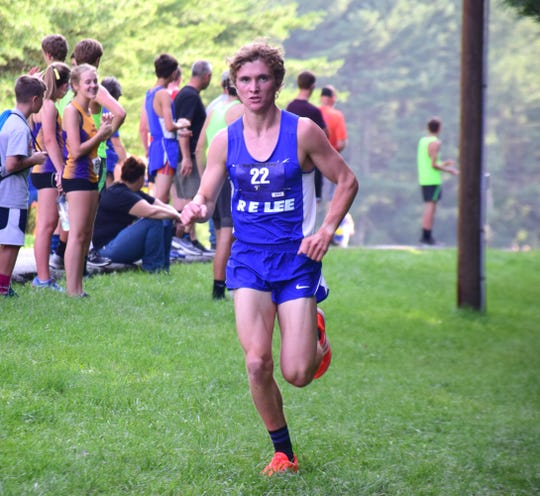 Robert E. Lee's Oliver Wilson-Cook leads the pack on the opening leg of the boys relay at the Valley Cup cross country invitational on Wednesday, Aug. 22, 2018, at Wilson Workforce & Rehabilitation Center in Fishersville. Va.