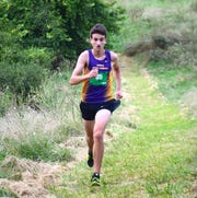 Waynesboro's Stuart Vailes runs the second leg of the boys relay at the Valley Cup cross country invitational on Wednesday, Aug. 22, 2018, at Wilson Workforce & Rehabilitation Center in Fishersville. Va.
