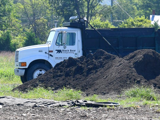 A pile of screened and ready compost next to a dump truck at Black Bear Composting in Crimora on Thursday, August 23, 2018.