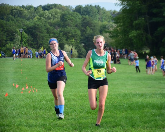 Wilson Memorial's Spencer Tuttle completes the anchor leg of the girls relay at the Valley Cup cross country invitational on Wednesday, Aug. 22, 2018, at Wilson Workforce & Rehabilitation Center in Fishersville. Va.