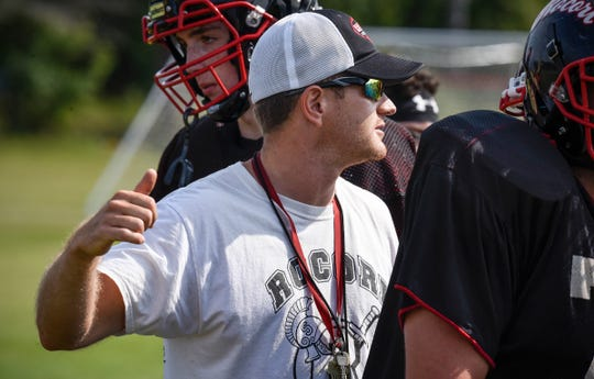 Head coach James Herberg talks to his players during practice Thursday, Aug. 16, at Rocori High School in Cold Spring.