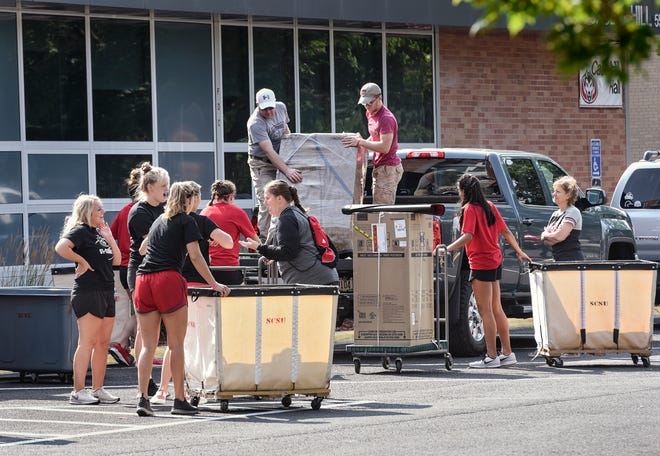 Student helpers move belongings for first-year students at Case-Hill Hall during the first residential move-in day Thursday, Aug. 23, at St. Cloud State University.
