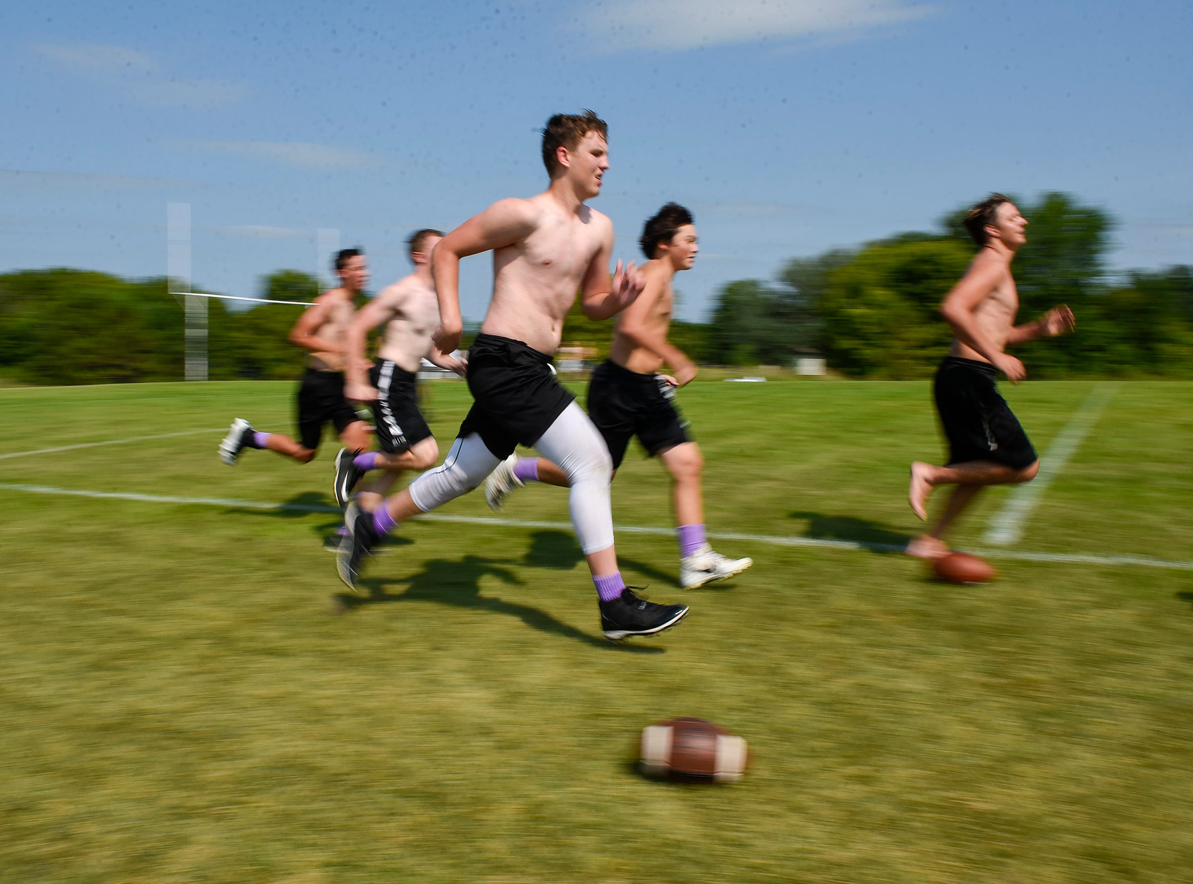 Albany players run conditioning spring after practice Wednesday, Aug. 15, at the Albany High School.