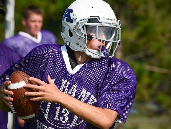 Albany quarterback Alex Seiler looks for a receiver during practice Wednesday, Aug. 15, at the Albany High School.