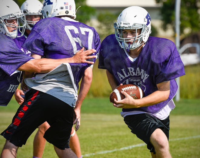 Albany running back Ben McLachlan breaks around the end on a play Wednesday, Aug. 15, at the Albany High School.