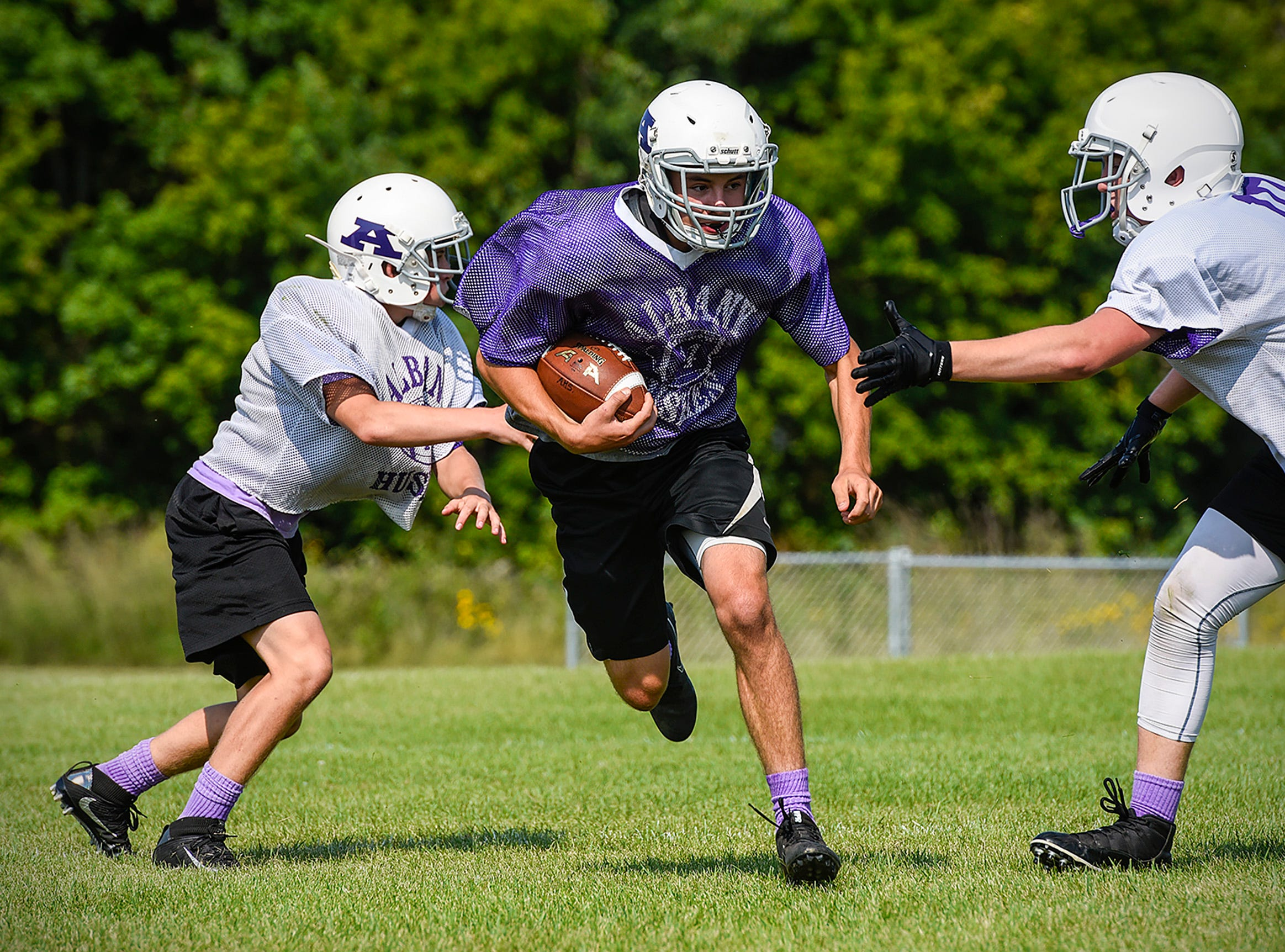 Albany back Dylan Wenning carries the ball during paractice Wednesday, Aug. 15, at the Albany High School.