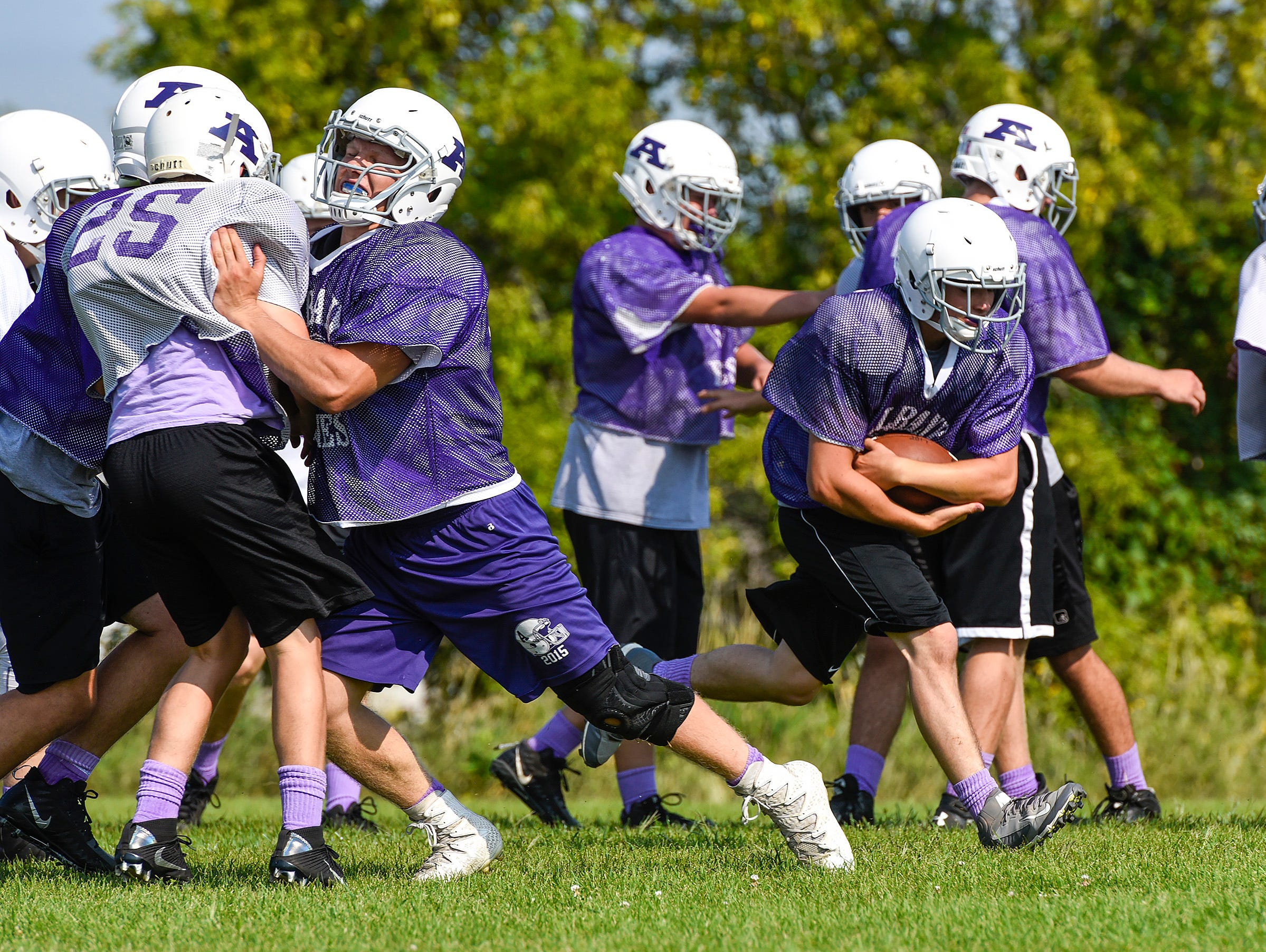 Albany Fullback Carter Kotzer breaks into the open during practice Wednesday, Aug. 15, at the Albany High School.