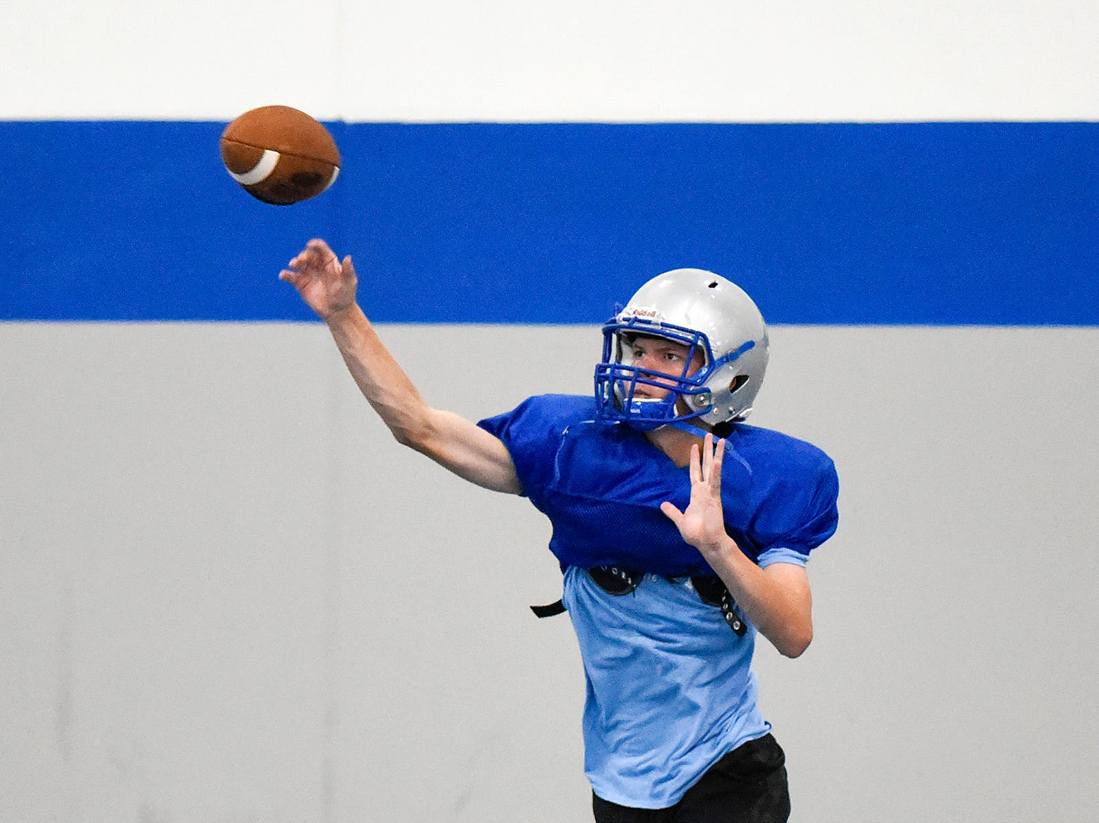 Foley quarterback Alex Foss makes a pass during practice Monday, Aug. 20, at the Foley High School.