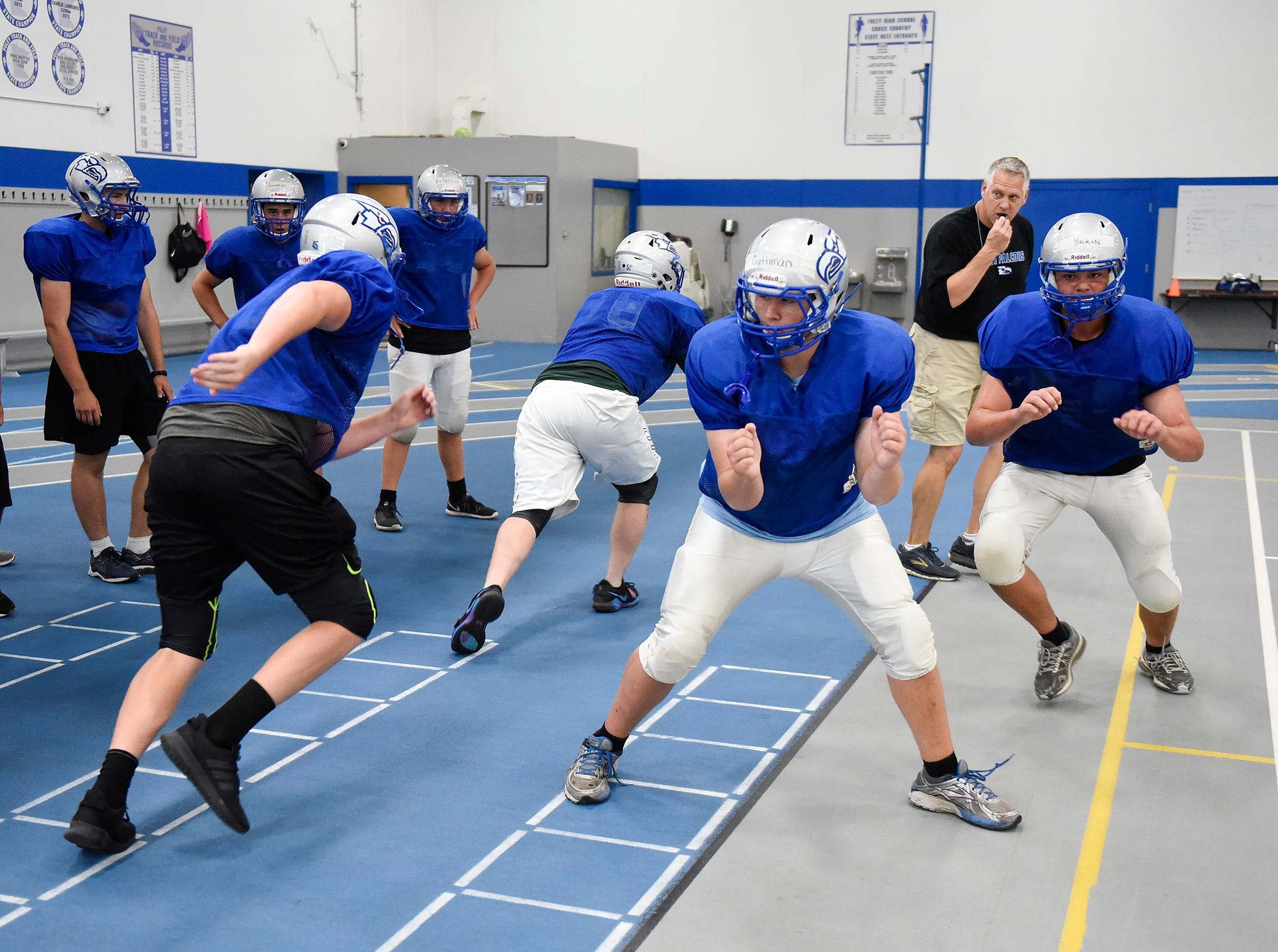 Foley's offensive line run their blocking plays during practice Monday, Aug. 20, at the Foley High School.