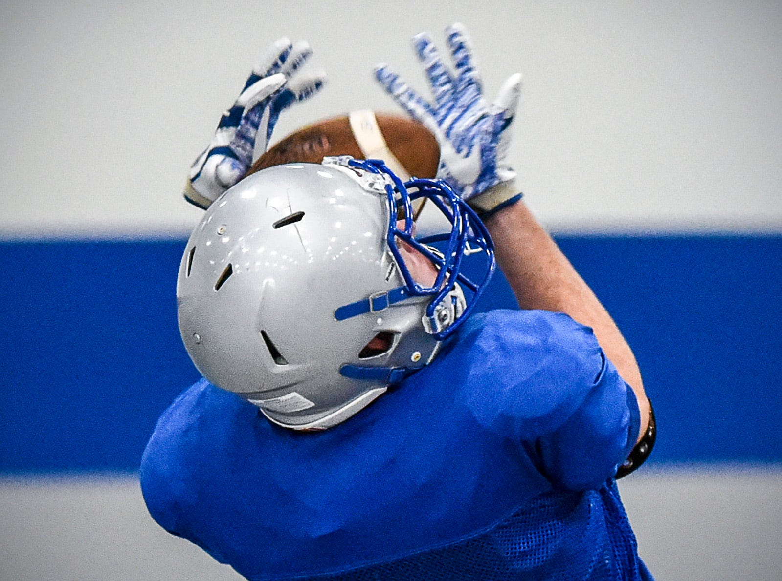 Foley wide receiver Mitch Peterson pulls in a pass during practice Monday, Aug. 20, at the Foley High School.