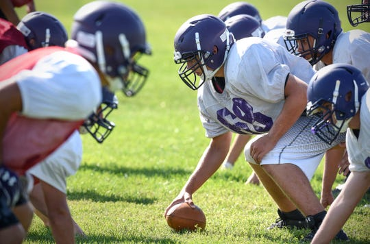 Little Falls players line up at the line of scrimmage before running a play in practice Wednesday, Aug. 22.