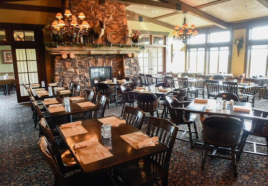 The dining room at Coyote Moon Grille overlooks Territory Golf Club, shown Thursday, Aug. 23, in St. Cloud.