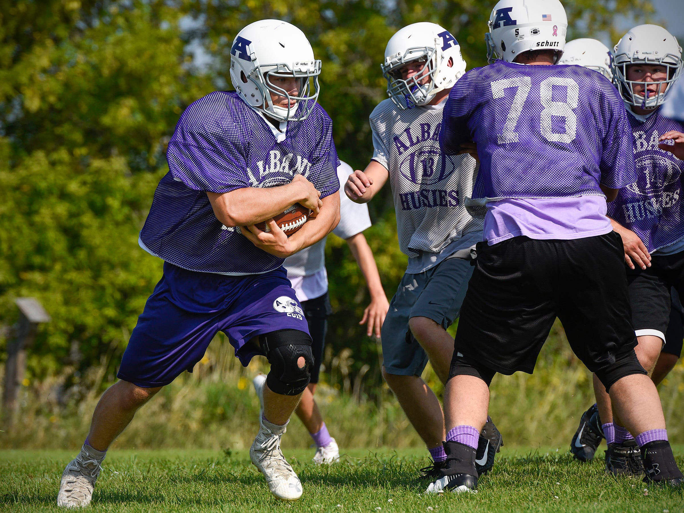 Albany Fullback Gabe Zierden gets room to run on a play Wednesday, Aug. 15, at the Albany High School.