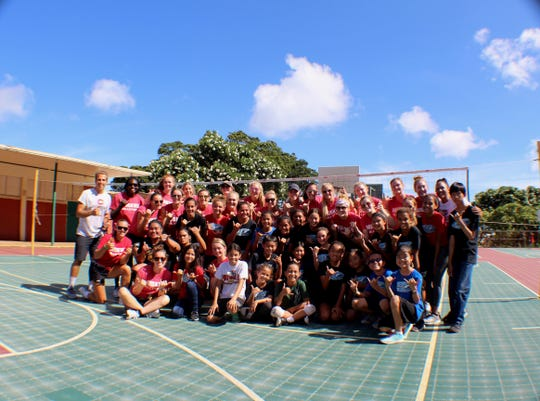 St. Cloud State University volleyball team members at a youth volleyball clinic in Hawaii.