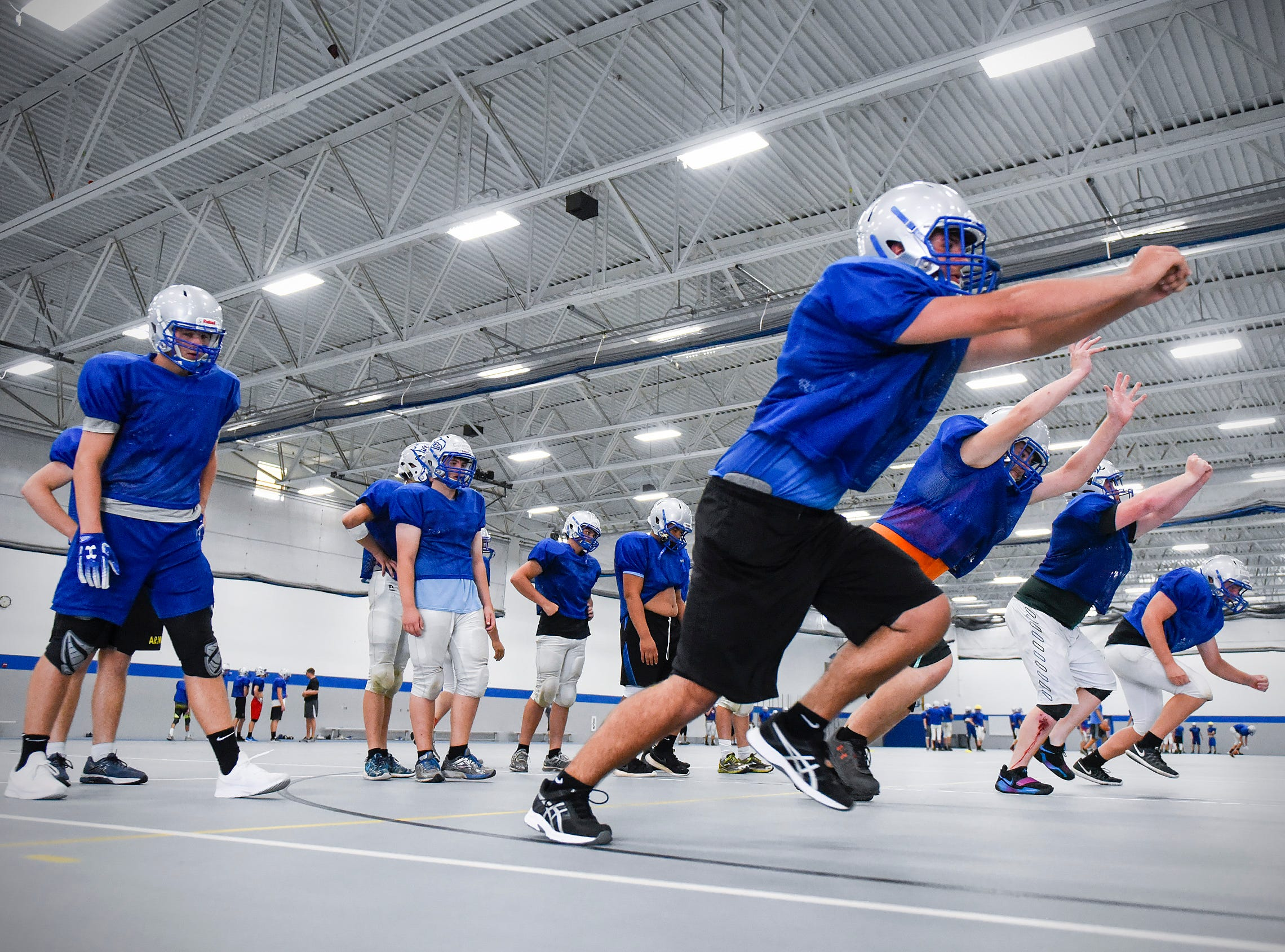 Foley's defensive line works on blocking during practice Monday, Aug. 20, at the Foley High School.