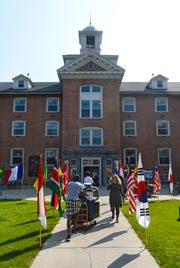 Flags from many nations greet students and their families to Lawrence Hall during the first residential move-in day Thursday, Aug. 23, at St. Cloud State University.