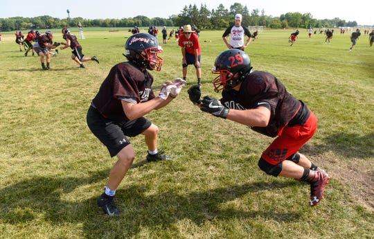 Players run through a drill during practice Thursday, Aug. 16, at Rocori High School in Cold Spring.